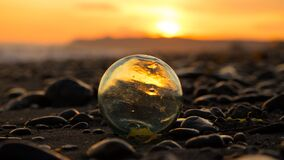 Free Japanese Hand-blown Glass Fishing Float On Rocky Beach At Sunset Royalty Free Stock Images - 186759959