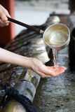 Japanese hand cleansing ritual Royalty Free Stock Photography