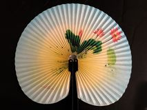 Japanese Hand Fan. Setup in a studio with a black background. This goes back to the World War Two era. This was bought in Japan Stock Image