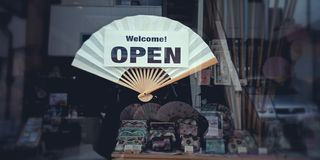 Welcome open sign on japanese hand fan royalty free stock image