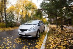 Japanese hatchback on autumn road. In rainy day Royalty Free Stock Photography