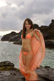 Japanese-hawaiian girl on lava Stock Photography