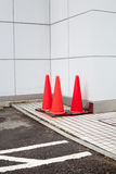 Japanese highway cones. Besides the building Stock Photo