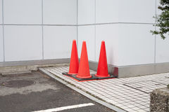 Japanese highway cones. Besides the building Royalty Free Stock Photo