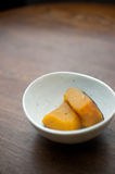 Japanese home cooking, Simmered pumpkin Royalty Free Stock Image