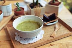 Japanese hot green tea and wire whisk made of bamboo Stock Image