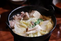 Japanese hot pot in small black pot. stock photography