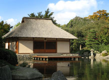 Japanese house. A Japanese house in a Japanese garden stock image