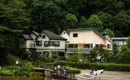 Japanese house. And people walk around the lake and chat Stock Image