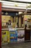 Japanese ice cream dessert stall with female counter staff in Tokyo Japan Royalty Free Stock Image