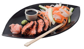 Japanese inspired salmon. On a black plate Stock Photo