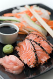 Japanese inspired salmon. On a black plate Royalty Free Stock Images