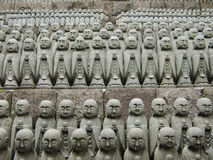 Japanese jizo sculptures. Rows of similar japanese jizo sculptures in Hase-Dera temple, Kamakura, these jizo stay here for comfort of  unborn children Royalty Free Stock Photos