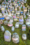 Japanese Jizo statues to remember deceased children. The aprons provide cloth for Jizo`s robe to protect the children in the afterlife royalty free stock photo