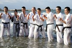 Japanese karate martial arts training at the beach royalty free stock photos