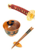 Japanese katana, Chopsticks and bowl Royalty Free Stock Photo