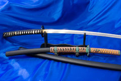 Japanese katana sword. The weapon of a samurai. A formidable weapon in the hands of a master of martial arts.  Royalty Free Stock Images