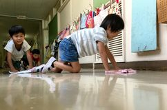 Japanese Kids Cleaning Their School Stock Images