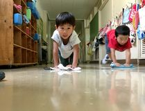 Japanese Kids Cleaning Their School Royalty Free Stock Image