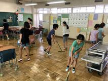 Japanese Kids Cleaning Their School Stock Photo
