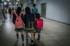 Japanese kids are going to school together with sisters by metro Royalty Free Stock Image