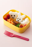 Japanese kids lunch box. On pink background royalty free stock images