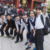 Japanese kids taking group selfie Royalty Free Stock Photos