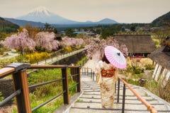Japanese Kimono woman with sakura and mount Fuji stock photography