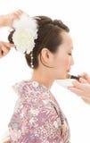 Japanese kimono women to make up Stock Image