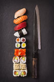 Japanese Knife with Sushi. As closeup on  a black slate Royalty Free Stock Photography