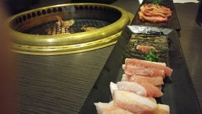Japanese / Korean bbbq. Flames leaped from the bbq as the Bork belly cooked royalty free stock photo