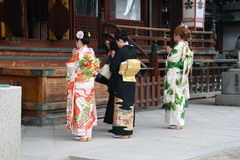 Japanese ladies praying in the temple. The Japanese wear Japanese clothing mainly for ceremonies and special events, funerals, coming-of-age ceremonies (seijin Stock Image