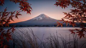 Japanese landscape at sunset. Mount Fuji viewed from Kawaguchi lake at sunset, Japan royalty free stock images