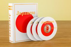Japanese language textbook with flag of Japan and CD discs on th. E wooden table. 3D Royalty Free Stock Photo