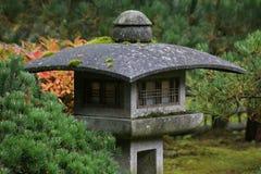 Japanese Lantern. Contemporary pedestal style Japanese lantern in garden setting royalty free stock image
