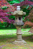 Japanese Lantern. In a stroll garden with decorative trees Stock Photography