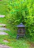 Japanese Lantern in Garden. With ferns and step stones stock image