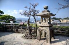 Japanese lantern and sakura at the Miyajima island, Japan. Traditional Japanese lantern and sakura trees on the Miyajima Itsukushima Island near the shinto royalty free stock photos