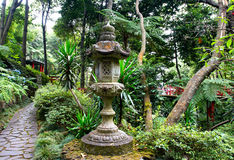 Japanese lantern in the tropical garden Royalty Free Stock Photos