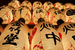 Japanese Lanterns. With Kanji characters on them at night Stock Photos