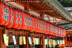 Japanese lanterns, hanging at a shinto shrine, kyoto. Rows of red paper japanese lanterns, hanging at a shinto shrine, Kyoto, Japan Royalty Free Stock Photo