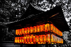 Japanese Lanterns. Surrounding building glowing orange in the evening Stock Photos