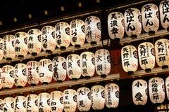 Japanese Lanterns at Yasaka Shrine, Kyoto. Illuminated Japanese Lanterns at the dance stage Yasaka Shrine, Kyoto, Japan. Each lantern bears the name of a local stock photo