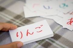 Japanese; Learning the New Word with the Alphabet Cards; Writing. Japanese; Learning the New Word with the Alphabet Cards Translation; Apple royalty free stock photography