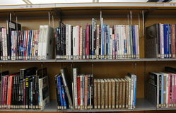 Japanese library Shelves full of Movie-related Books. Library shelves containing movie books in a public library in Japan. Photo taken December 2016 Royalty Free Stock Photo