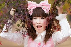 Japanese lolita fashion. Japanese girl in lolita cosplay fashion in park royalty free stock images