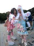 Japanese Lolita Fashion Girls Cosplaying in the Park Royalty Free Stock Image