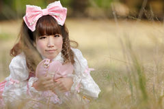 Japanese lolita in meadow Stock Image