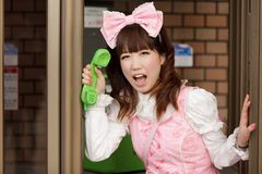 Japanese lolita public phone Royalty Free Stock Images