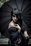 Japanese look, pretty young woman with black umbrella, under aut Royalty Free Stock Photos